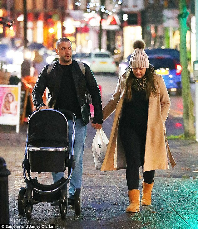 We are family:And singer-turned-actor Shayne Ward and his stunning partner Sophie Austin appear to be taking to parenthood swimmingly as they were spotted indulging in some Christmas shopping in Manchester on Monday