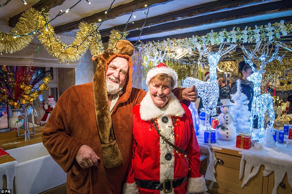 Sheila and John (both pictured) inside their house which they have opened up to visitors over the festive season