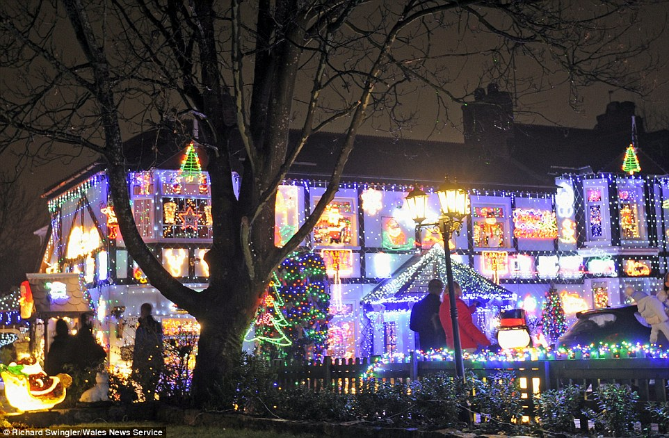 Hundreds of people each year gather outside some of the most popular houses who have made this an annual tradition