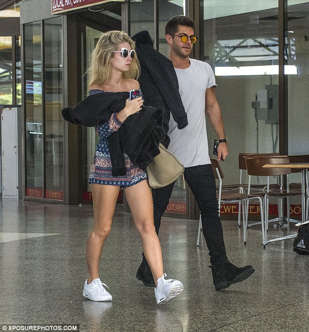 S-mytton! The pair still looked loved-up as their holiday came to an end - chatting happily after checking their bags in