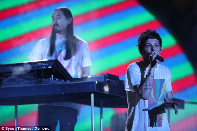 True pro: Despite his heartbreaking loss Louis decided to continue with his planned live performance on the X Factor final on Saturday night  - which his Instagram refers to