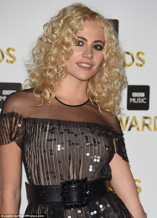 Wild thing: The singer glammed up the look by styling her blonde locks into big and bold curls - drawing attention to her dewy make-up stunning features