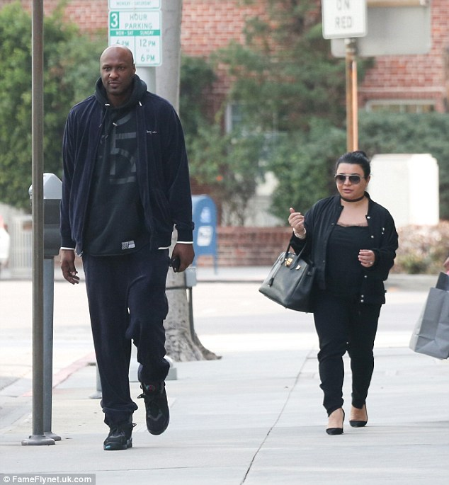 Seemed to be on track: While it is not known exactly when Lamar entered rehab, for the past few weeks he has been out and about (pictured here with his publicist Eve Sarkisyan-Nunn on December 6 - the last time he was seen publicly)
