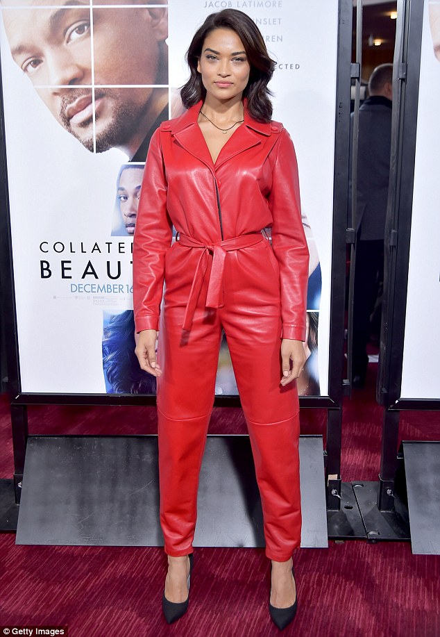 That's not like her! Shanina Shaik hid her slender figure with a billowing red pantsuit on Monday as she attended the Collateral Beauty world premiere in New York