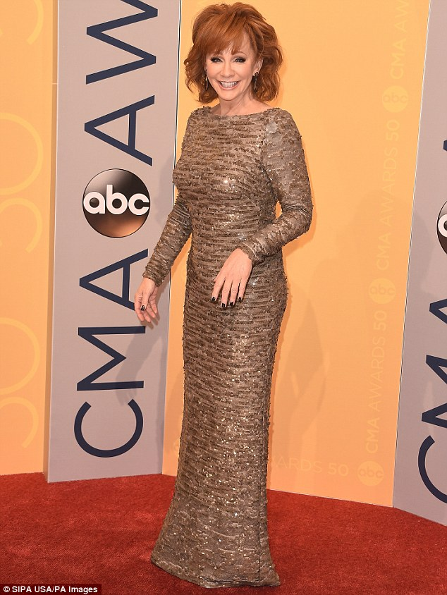 TV star: Reba McEntire, 61, is returning to the small screen for a lead role in an untitled drama for ABC. She is pictured in Nashville in November