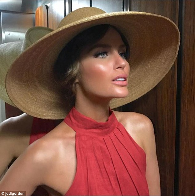 Vintage vixen! Jodi Anasta channels old Hollywood glamour in large wide brimmed hat and pleated halterneck top in ode to Marion Cotillard's new role in film Allied on Instagam on Monday