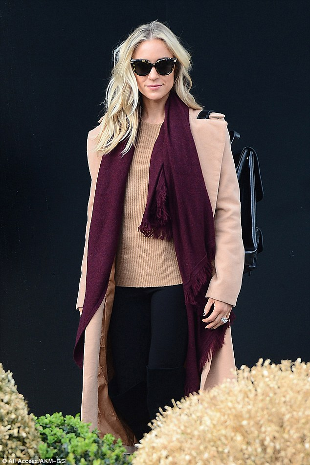 Planet claret: She kept the palette seasonal, with a long wine scarf, and stylish black trousers