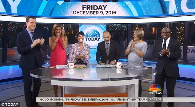 Support system: Everyone at the Today show gathered around the anchor desk on Friday to announce the happy news and congratulate Savannah