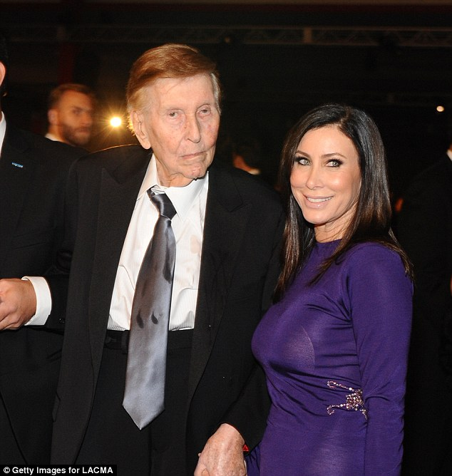 Bombshell:Sumner Redstone's ex claims in court papers that the 93-year-old gave out over $70m to women who 'did nothing more than provide sexual favors' (Redstone and Sydney Holland above in 2013)