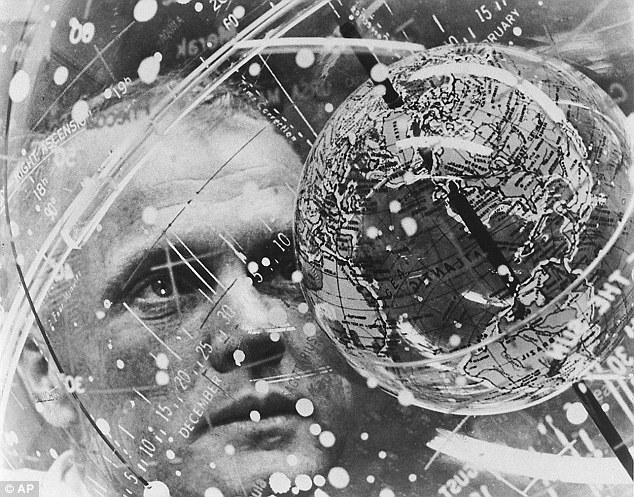 Glenn looks into a Celestial Training Device globe at the Aeromedical Laboratory at Cape Canaveral in February 1962 shortly before his trip into space, which lasted just five hours