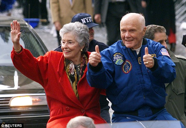 Glenn gives the thumbs up as he rides in an open car with his wife Annie during a ticker tape parade, his third, in November 1998 after returning from space aboard Discovery (above)