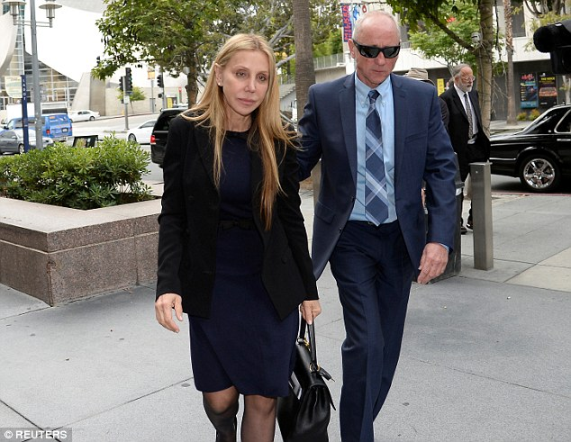 The lawsuit comes just a few months after Herzer filed her own lawsuit against Redstone. The judge in the case made the decision to dismiss that $50million suit. She is pictured outside court during the proceedings, where she wanted to be put in charged of his estate