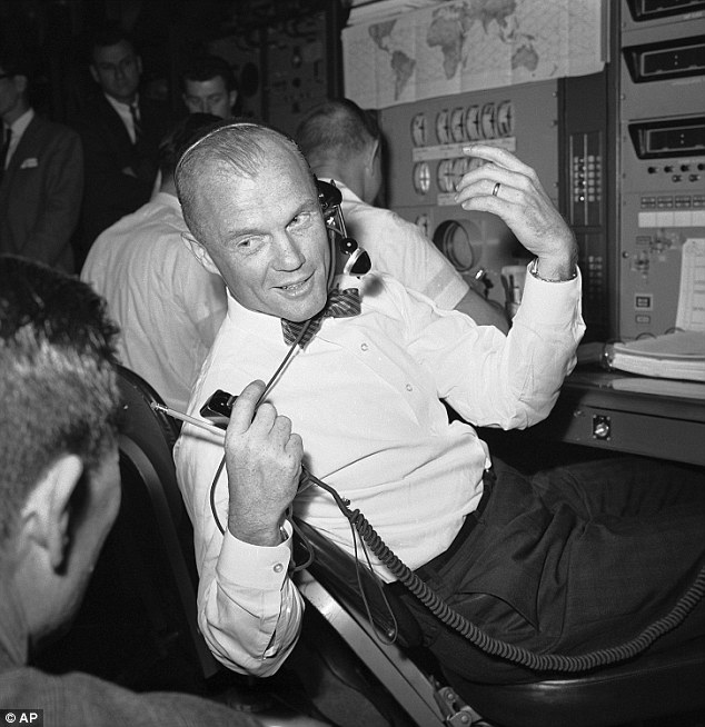Glenn back Cape Canaveral one year after his famed mission in May 1963 (above) to perform a test in the telemetry control room aboard the NASA tracking ship, the Coastal Sentry