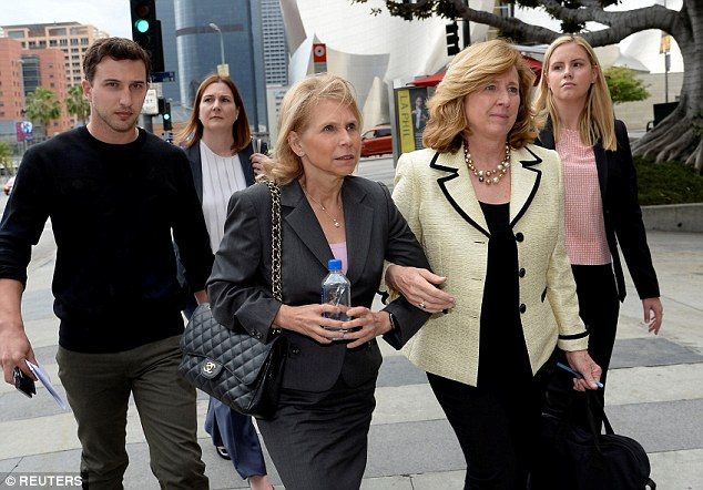 Sumner Redstone's daughter Shari Redstone (center)  leaves a downtown courthouse in Los Angeles during hearings in the lawsuit filed by Herzer