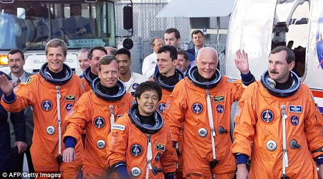 The crew of the Shuttle Discovery preparing the board the spaceship before taking off into space in 1998 ( l to r: Scott Parazynski, Stephen Robinson, Pilot Steve Lindsey, Chiaki Mukai, Pedro Duque, Glenn and Commander Curt Brown)