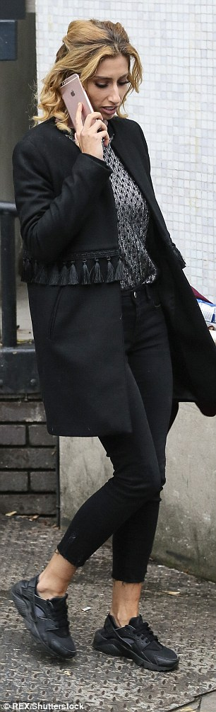 Looking good! Opting for comfort, she rocked a black tasseled coat and Nike trainers
