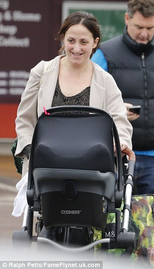 Happy place: The actress couldn't stop smiling at her baby daughter as she pushed her along