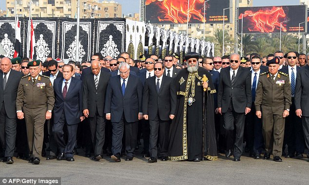 President Sisi (centre, in the black tie) leads the funeral procession. He is a former general who is perceived as a tough man in the mould of Egypt's legendary former leader Gamal Abdel Nasser but he has been unable to keep a lid on Islamic fundamentalist violence
