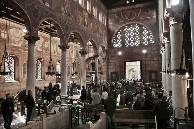 Security forces examine the scene inside the St. Mark Cathedral in central Cairo