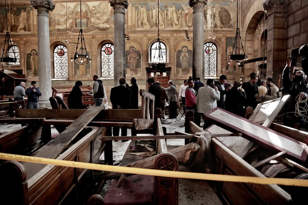 Security forces examine the scene inside St Mark Cathedral in central Cairo, following the bombing