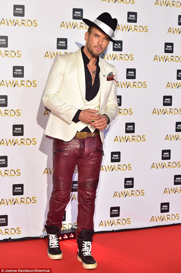 Leather lad: Matt Goss insists he is totally single as he spoke exclusively to MailOnline about his love life while attending Monday night's BBC Music Awards in London - where he dazzled the red carpet with a funky pair of red leather trousers
