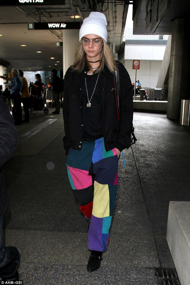Eccentric fashionista: Cara Delevingne went all out when she wore a peculiar ensemble as she landed at LAX from London on Monday