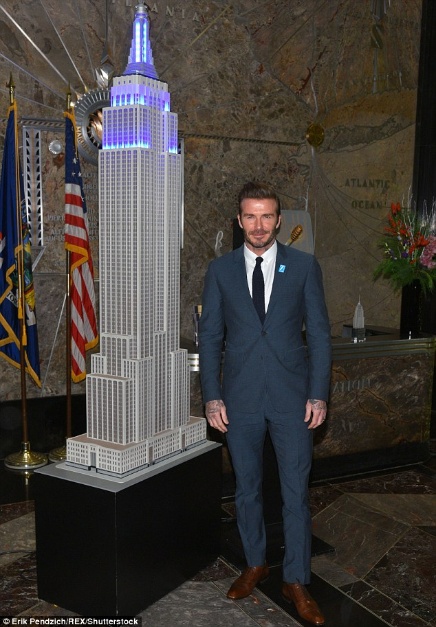 Cool man: Later that day, David looked dashing as he illuminated the Empire State Building in New York City blue to commemorate UNICEF's 70th anniversary