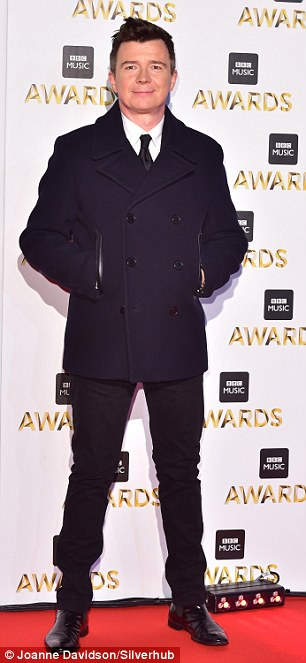 Never gonna let you down: Meanwhile Rick looked his usual formal self in tailored trousers, which he sported beneath a chunky winter coat
