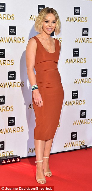 Classic: Katie Piper kept things simple but very effective in a plain rust dress which hugged her svelte physique
