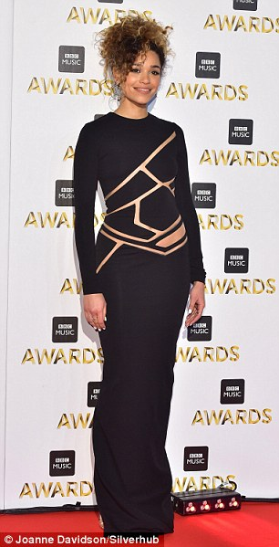 Cut-out for the catwalk: Izzy's laser cut dress clung to her gorgeous figure as she struck a fierce pose at the bash