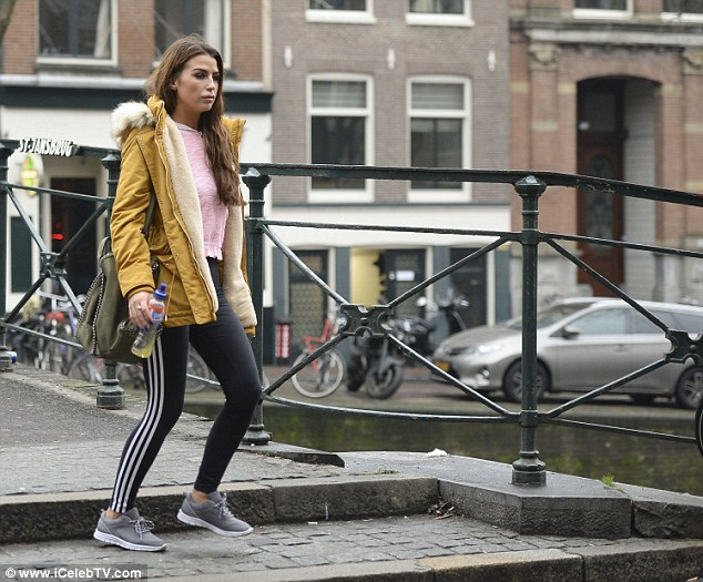 Wrapping up warm: She added a pink zip-up track top to the mix, over which she threw a warm mustard parka jacket