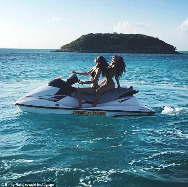 'Love': Emily posed for another photo with Bella in between jet skiing