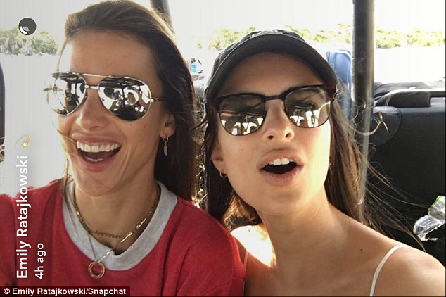 Smiling ear to ear:Emily donned sunglasses and a baseball cap for another snap; she posed alongside a beaming Alessandra