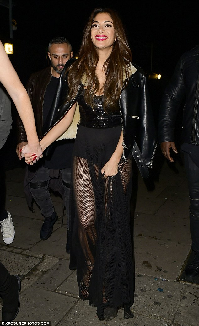 Plenty to smile about: Nicole Scherzinger had cause to celebrate as she stepped out in London after guiding Matt Terry to The X Factor crown on Sunday evening