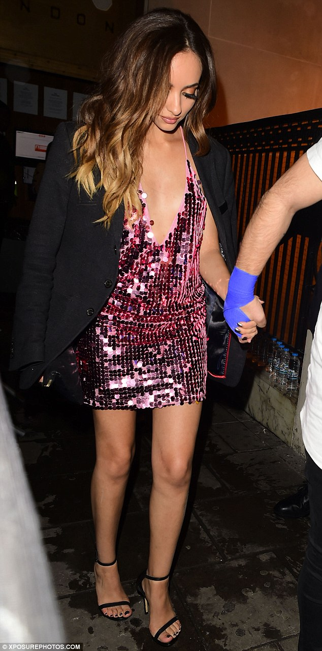 Dazzling: Opting for a thigh-skimming sequinned minidress and strappy black heels, Jade, 23, looked typically stylish as she arrived hand in hand with a male pal