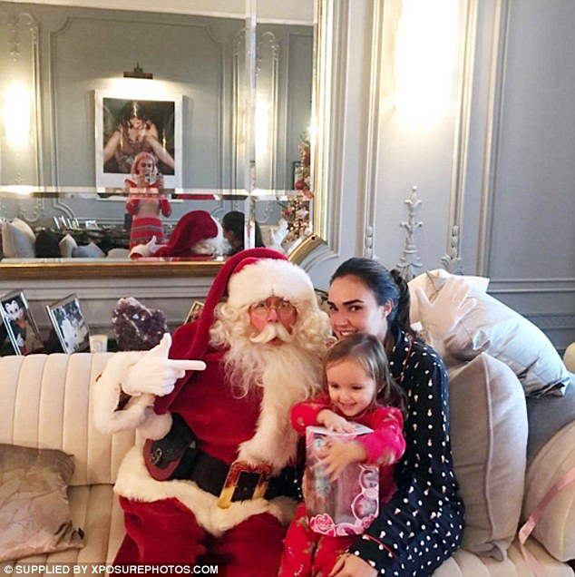 Look who came to visit! The family enjoyed a visit from Santa in one adorable Instagram snap