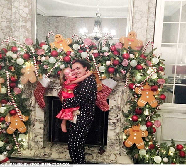 Festive fun: The mother and daughter showed off their impressive Christmas decorations