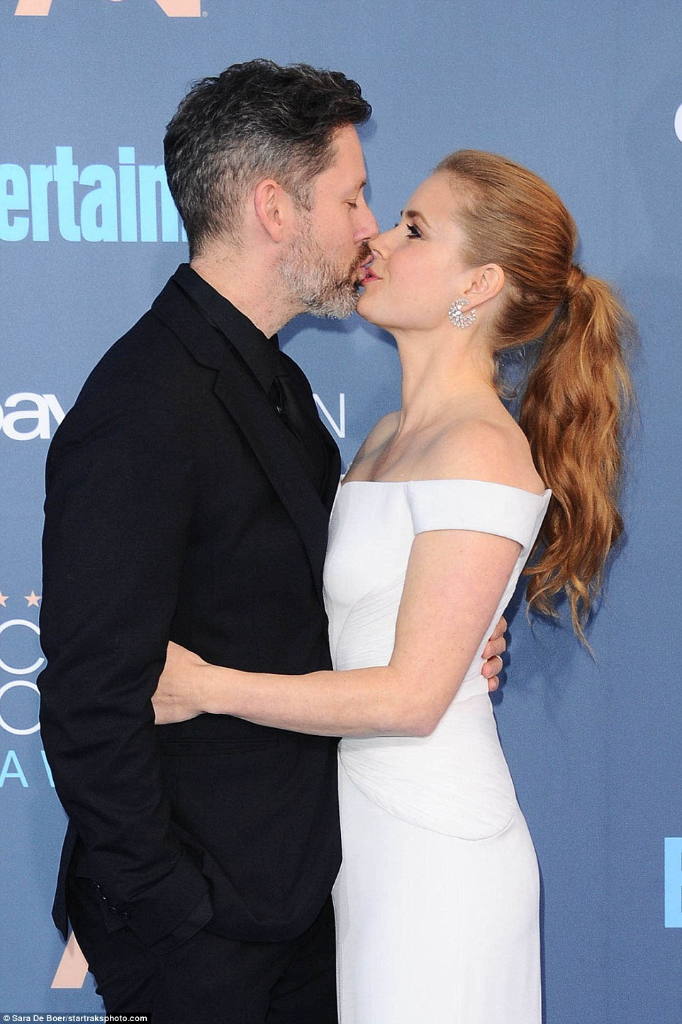 Pucker up! The Nocturnal Animals star shared a smooch with her husband in front of cameras