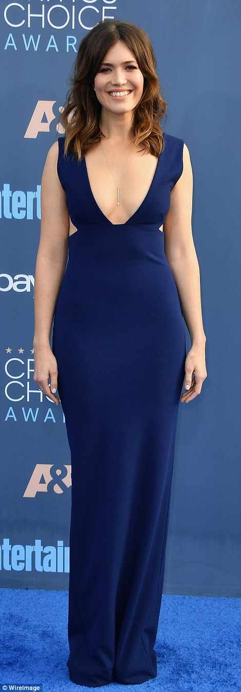 Beauty in blue: Moore took the plunge in a navy Solance London gown and understated jewelry