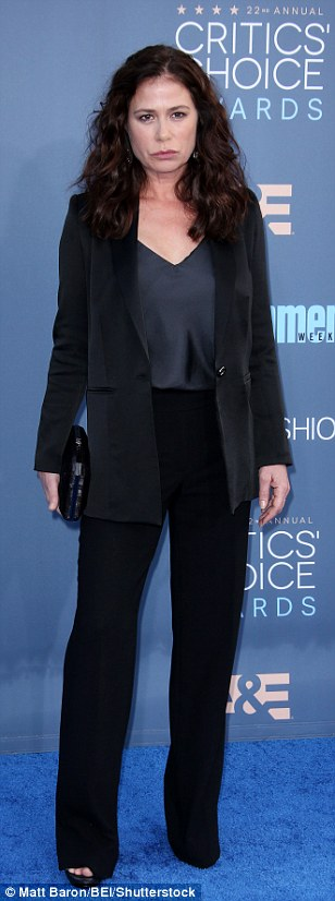 Something a little different: Maura Tierney, Lili Taylor and Evan Rachel Wood looked ready for business in black trouser suits