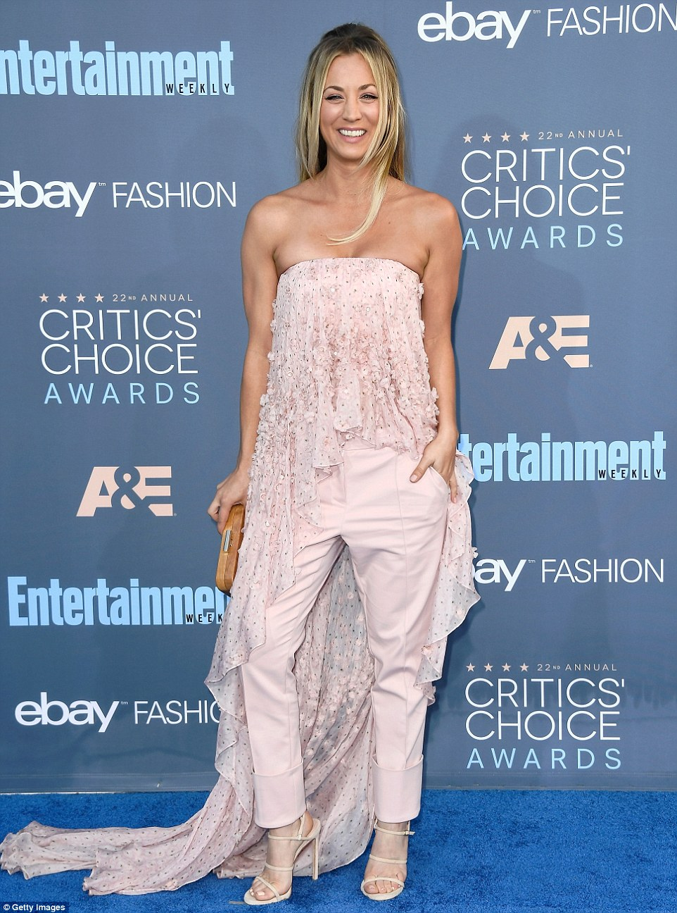In the pink! Kaley Cuoco donned a pastel pink two piece (by Noon By Noor) including frilly strapless top