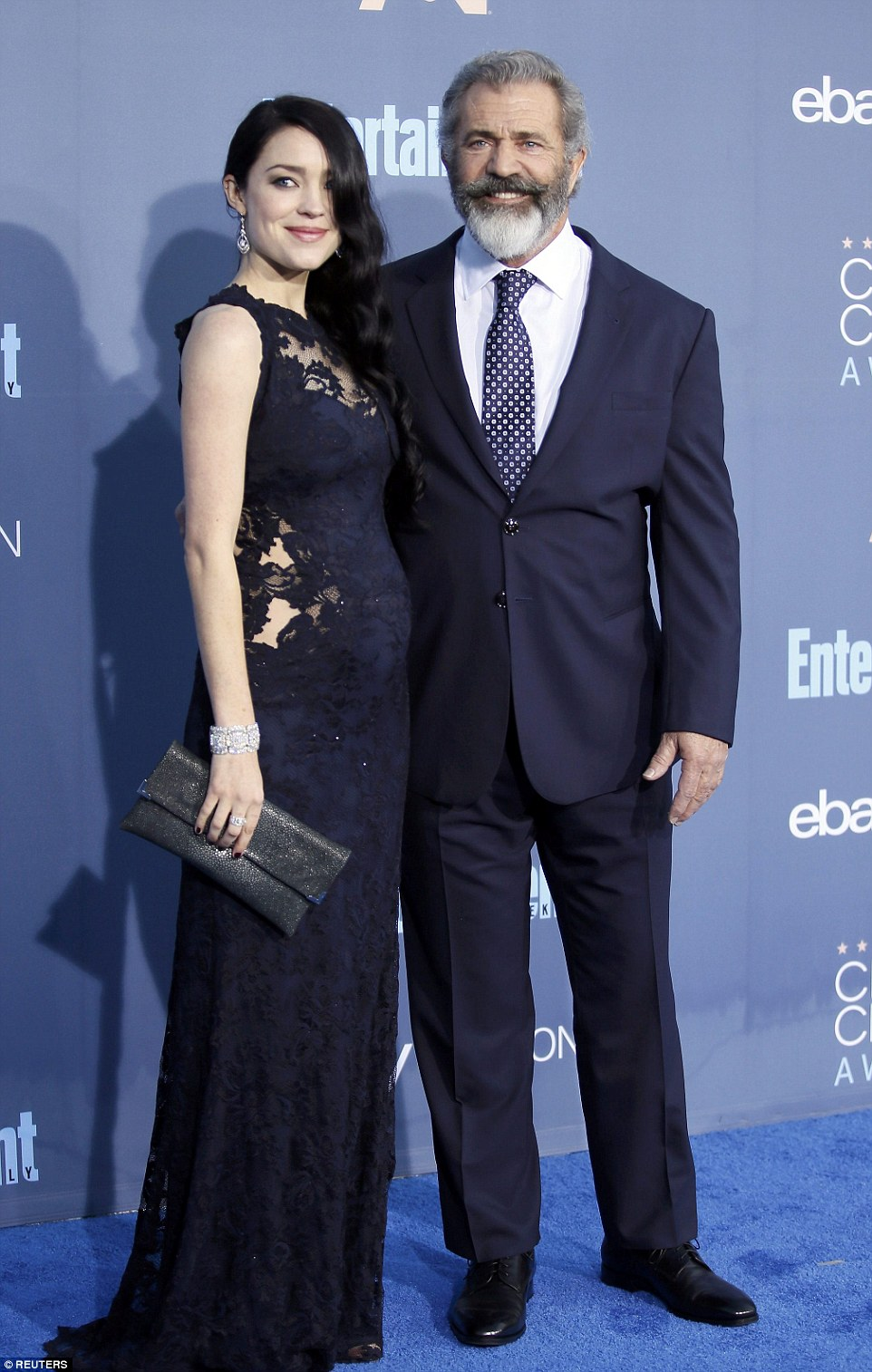 Stylish stars: Mel Gibson and pregnant girlfriend Rosalind Ross coordinated in midnight blue