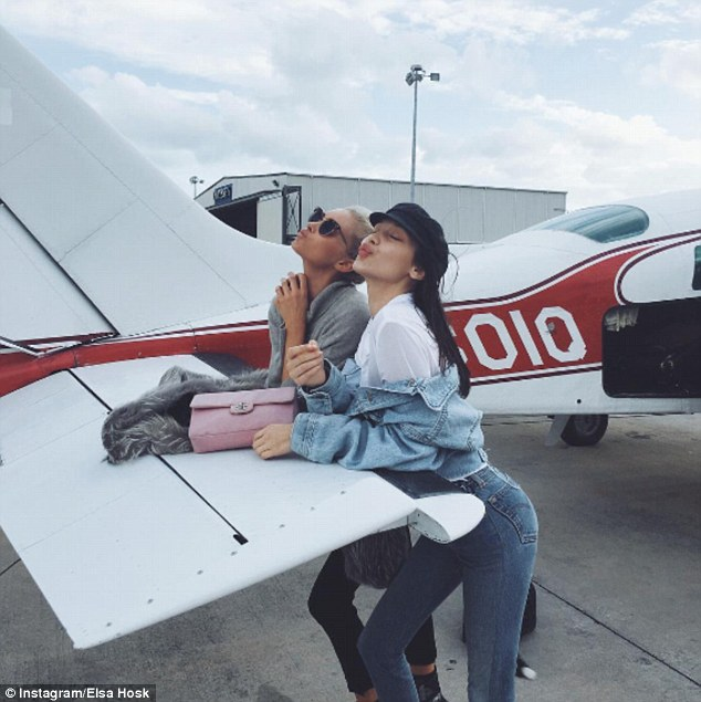 Jet-setters: Elsa posed for a snap with model of the moment Bella Hadid as they prepared to board a private jet to whisk them off to paradise