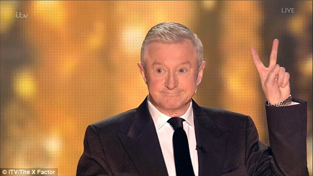 Peace: Louis Walsh shot a peace sign when he joined the judges for a spectacular arrival