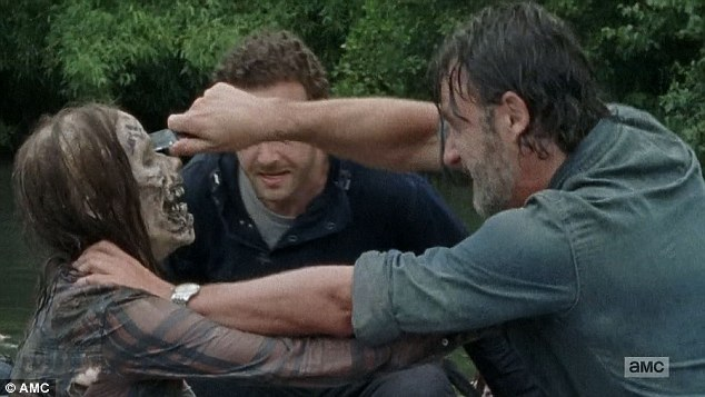 In the face: Rick took out a walker that was lunging at Aaron
