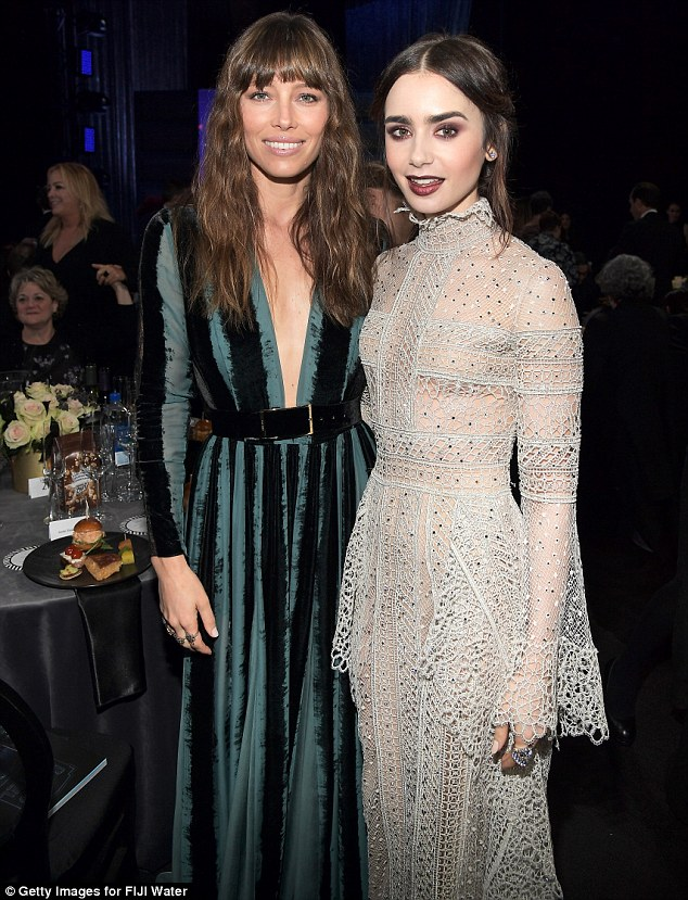 Stylish stars: Jessica and Lily Collins bot wore gorgeous Elie Saab gowns