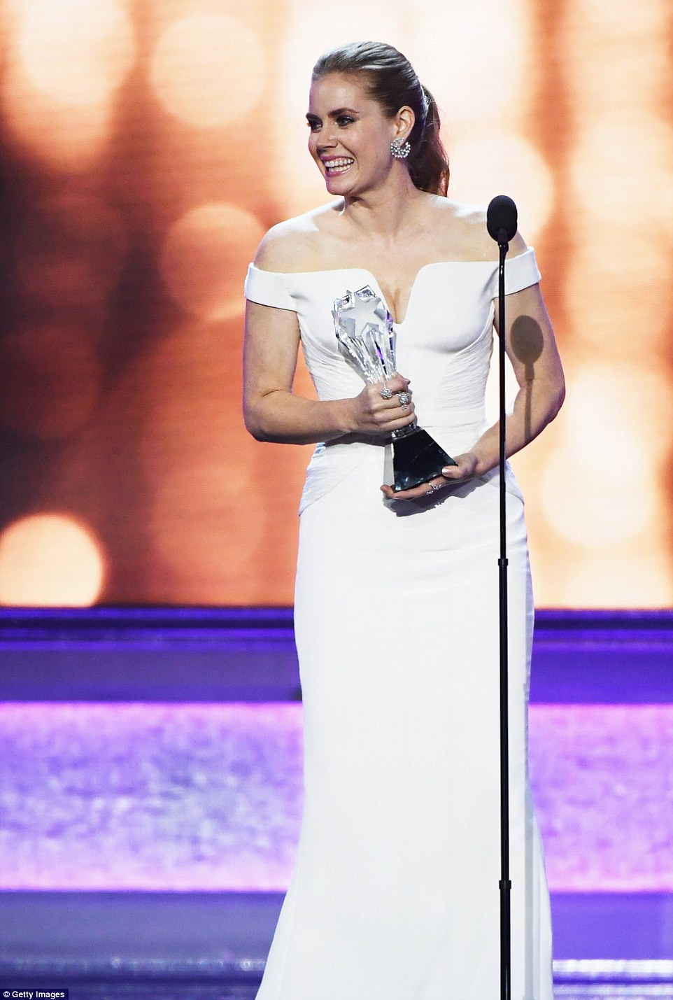 Wonder in white: Amy Adams looked gorgeous as she presented the prize to the veteran actress