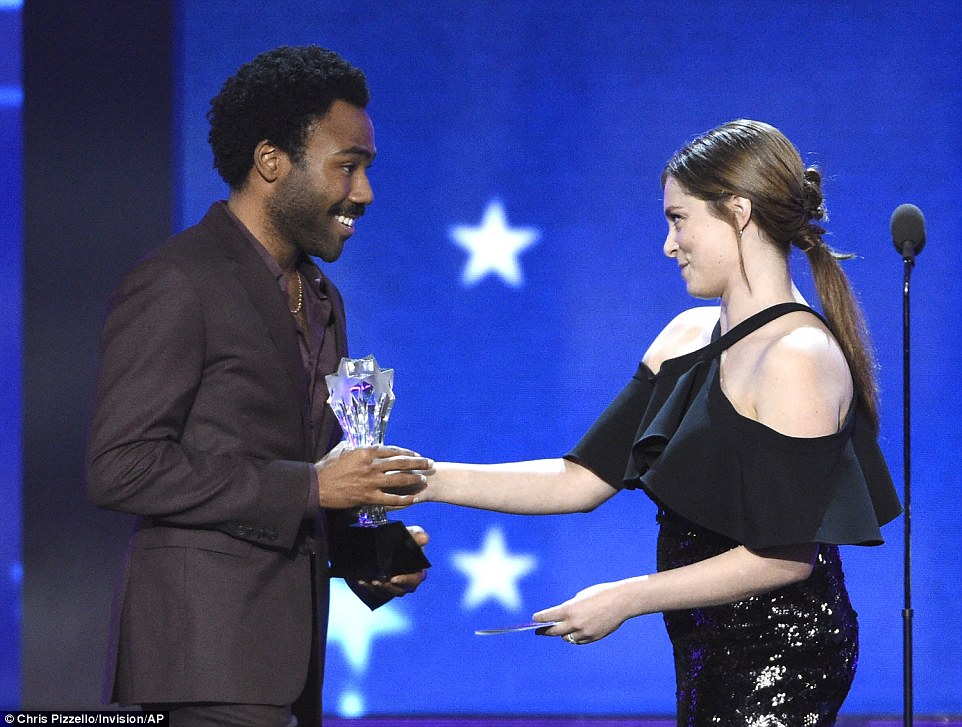 Excited: The rapper and actor was given the award by actress Rachel Bloom