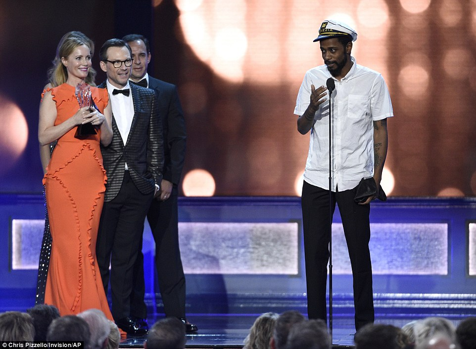 Eyes on the prize: The actor and rapper - who was comically dressed in a captain's hat - managed to beat Silicon Valley's executive producer Tom Lassally to the microphone