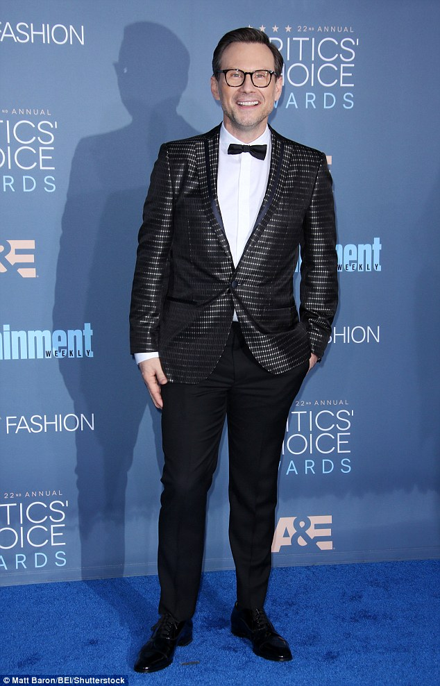 Can't miss him:Christian was throwing it back to his Eighties glory days in a shimmering black and silver checked suit jacket